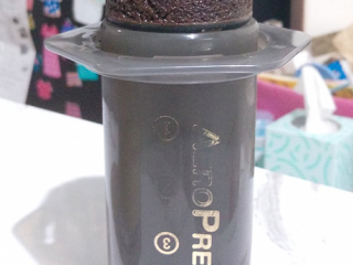 Coffee grounds puck from making overnight cold brew with the AeroPress