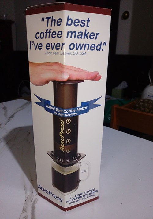 An AeroPress box sitting on a kitchen bench.