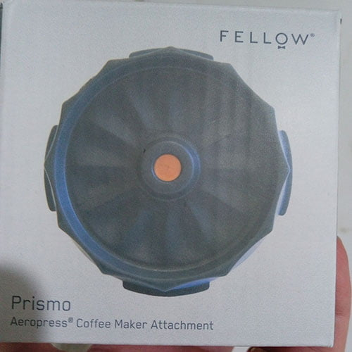 front of the fellow prismo box