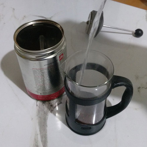 pouring hot water into the coffee plunger